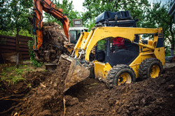 Landscaping Works With Bulldozer And Excavator At Home Construction Site.jpg