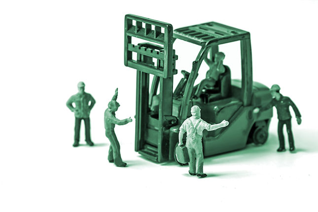 green miniature construction workers