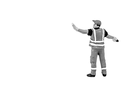miniature construction worker black and white holding hand up