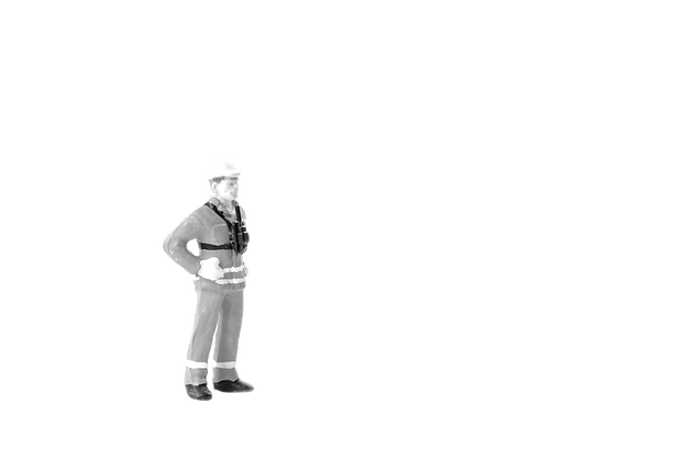 miniature construction worker black and white hands on hips