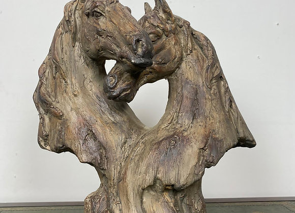 A Heart Shaped MGO Statue of Two Horse Heads