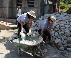 Tracey and Taylor moving rocks.jpg