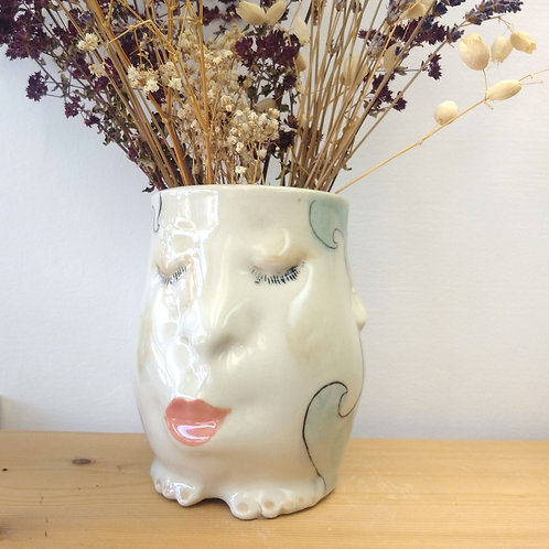 6 inch face vase with gold fish