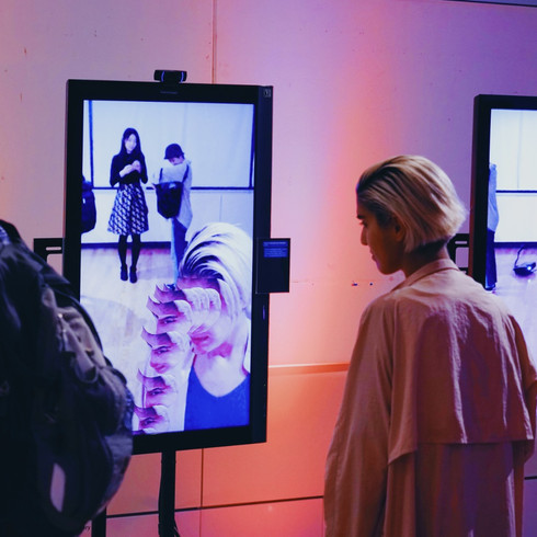 Surrounded by Digitized Faces and Bodies