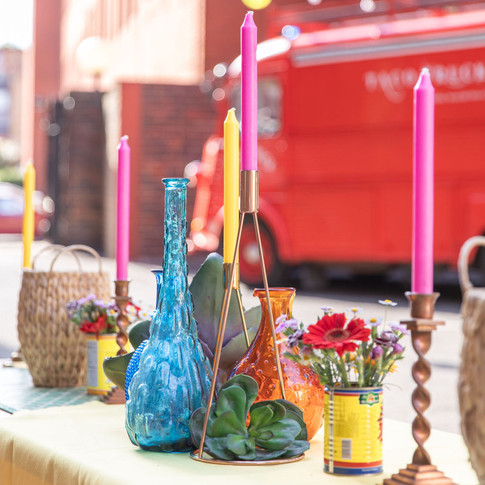 Low seating, vintage props and colourful food carts for a Summer office festival