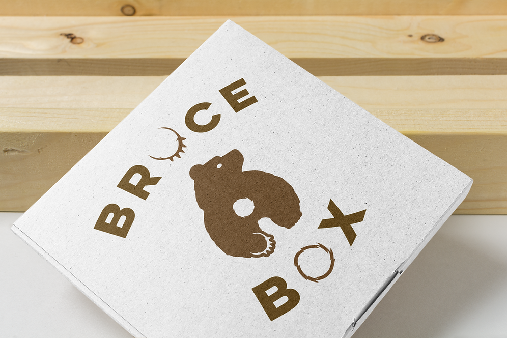 mailing-box-mockup-with-a-wooden-background-1664-el.png