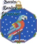 Harlequin Macaw Snowglobe Ornament id 15401
