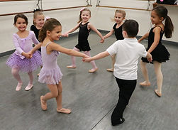 kids dancing in a circle, kids holding hands