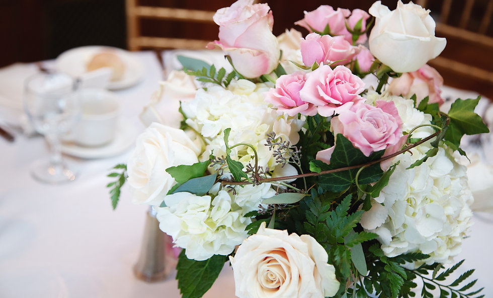 Cream and pink wedding roses and centerpieces