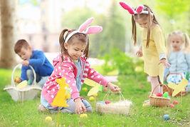 Children having fun in park. Easter egg