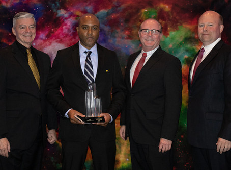 Aerodyne Industries LLC presents President's Award to D. Hardin