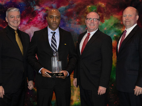 Aerodyne Industries LLC presents President's Award to D. Hardin