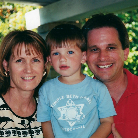 Ethan on his fourth birthday with his parents