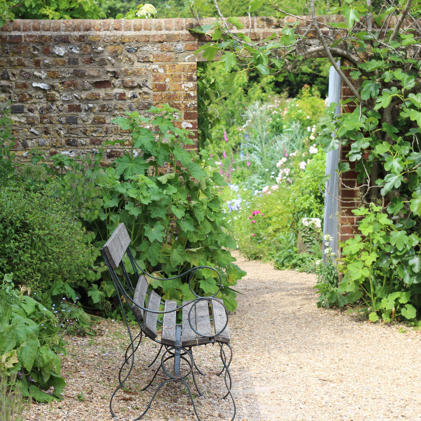 Seat by walled garden