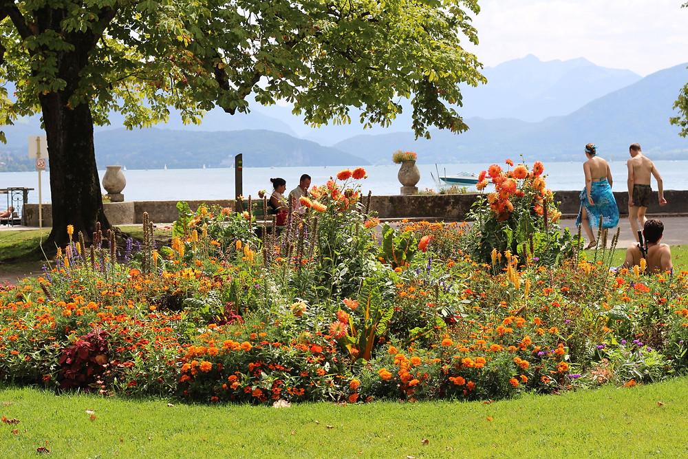 People relax around orange borders