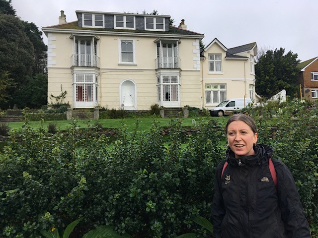 Gardener Polly Carter at Talland House by the escallonia hedge