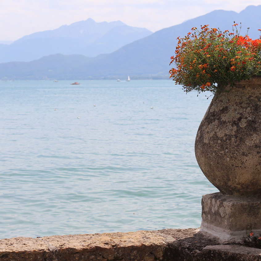 Stone planter with lakeside view