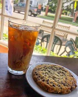 An iced coffee, a hot cookie, and a view