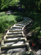Brick paver steps with wood beam border (under construction)