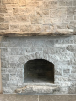 Storncloud fireplace with fossil (below firebox)