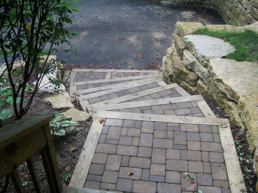 Brick paver steps with wood beam border