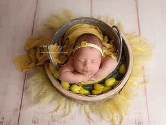 White, pink, grey and yellow- coloures which Parents selected for their girl newborn photo session