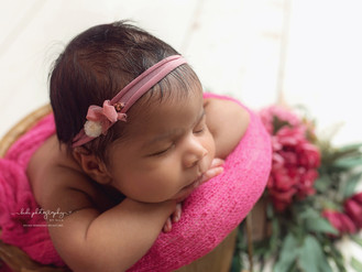 Aria and her professional newborn photo session.