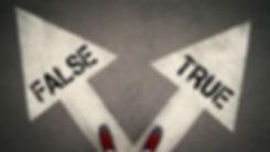 TRUE versus FALSE written on the white a
