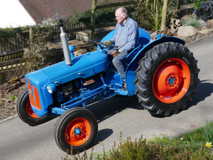 Peter gives his restored tractor its first outing - freedom