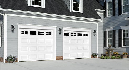 white traditional style Amarr residential garage doors