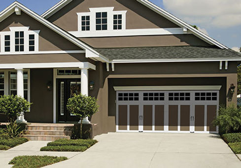 white and brown Clopay residential garage doors