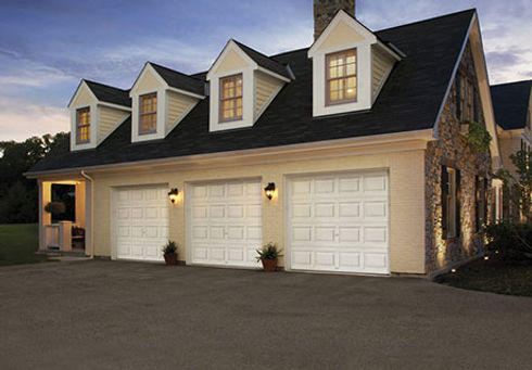 white traditional Clopay residential garage doors