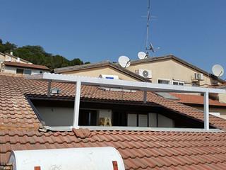 פרגולת אלומיניום בגג הבית