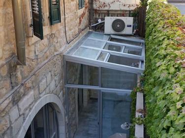 גג הזזה חשמלי לחדר שמש