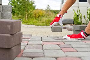 worker-laying-paving-stones-stone-paveme