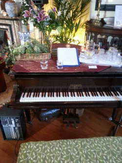 Piano with flowers on it