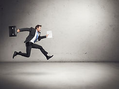 businessman running with papers and brie
