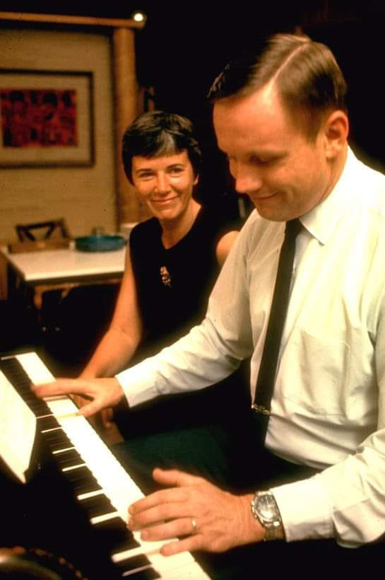 Armstrong with Jan, playing piano