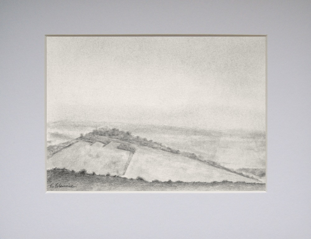 a graphite landscape scenes showing steeply sloping hill  with distant fields and hedges