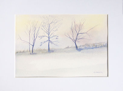 a peaceful countryside watercolour with three trees and snow