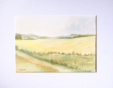 peaceful countryside watercolour showing fields and distant hills