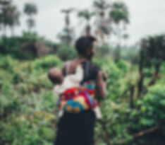 mozambique mother holding a child