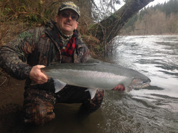 john with fish at river.jpg
