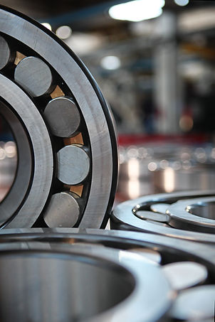 Macro photo of a bearing in production. Large glossy round shape. Industrial industry conc