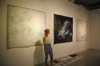 Artist with triptych