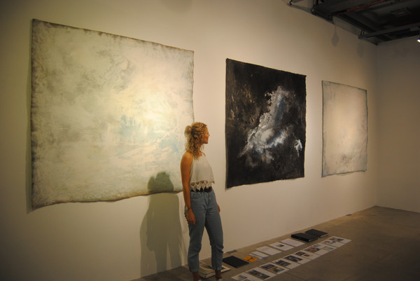 Artist with triptych