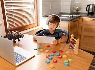 long-shot-child-attending-virtual-school