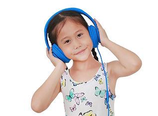 asian-little-girl-listening-music-by-hea