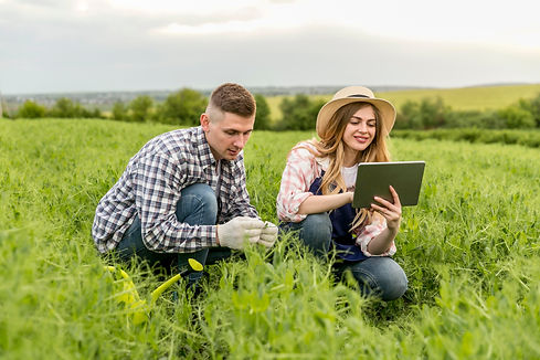 couple-working-at-farm-with-tablet.jpg