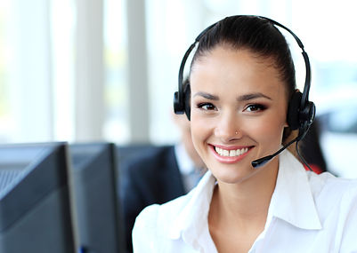Speedy Clearances Contact us - Image of a women with phone headset on